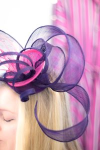 pink and purple headpiece with dress behind