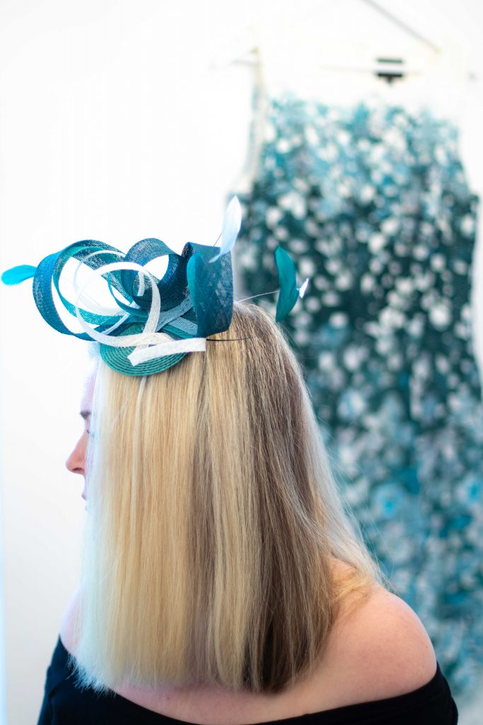 teal headpiece with teal dress behind