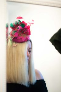 front view of pink felted flowers headpiece