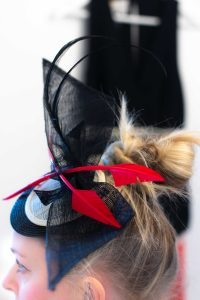 side view of red black and cream headpiece