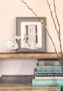 Oscar Wilde purple book cover and two white crowned swans