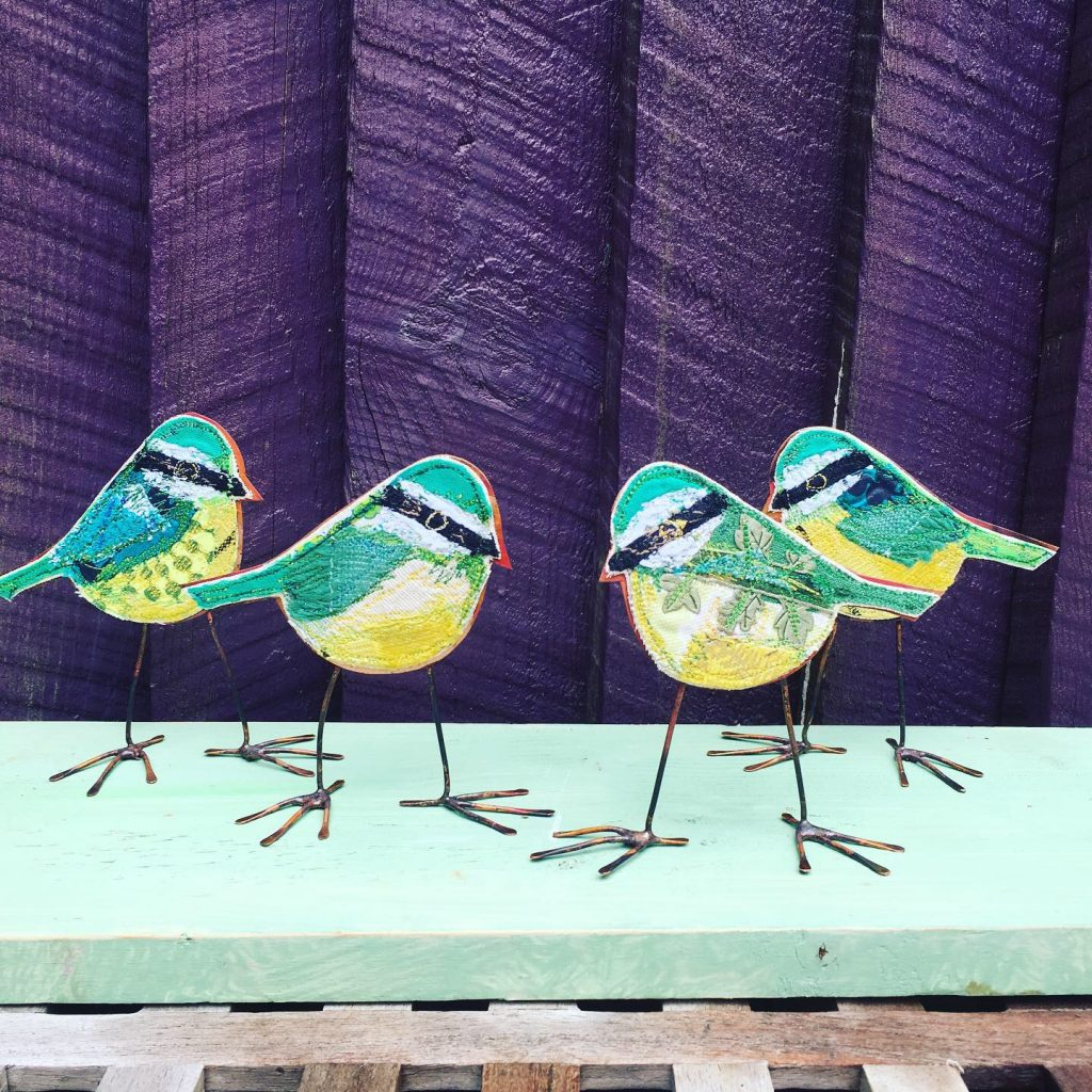 Four greeny blue tit embroidered birds