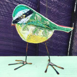 Close up of green blue tit embroidered bird