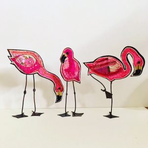 Three embroidered flamingoes with copper bodies