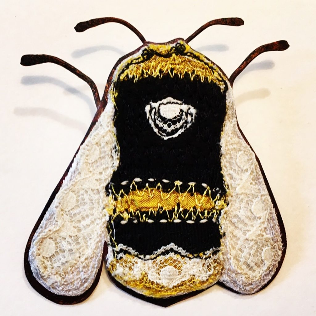 Big embroidered bee with copper body