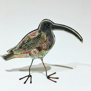 Embroidered curlew with copper body