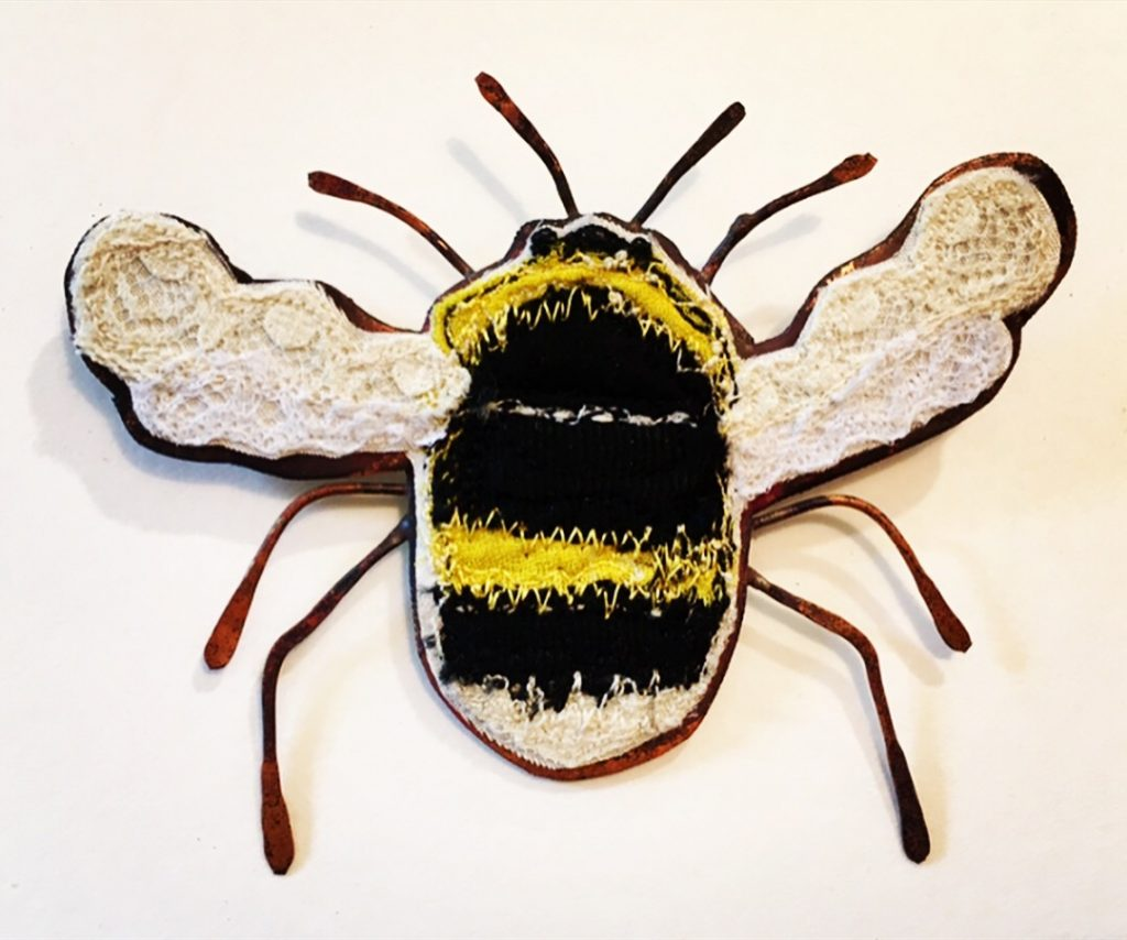 Small embroidered bee with a copper body.